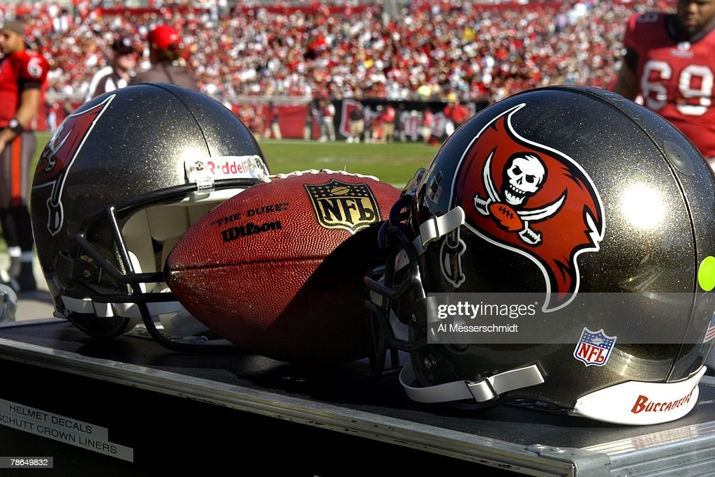 Helmets and an NFL football set behind the bench as the Tampa Bay Buccaneers host the Atlanta Falcons at the Raymond James Stadium on December 16, 2007 in Tampa, Florida. The Bucs won 37 - 3 and clinched a playoff berth.