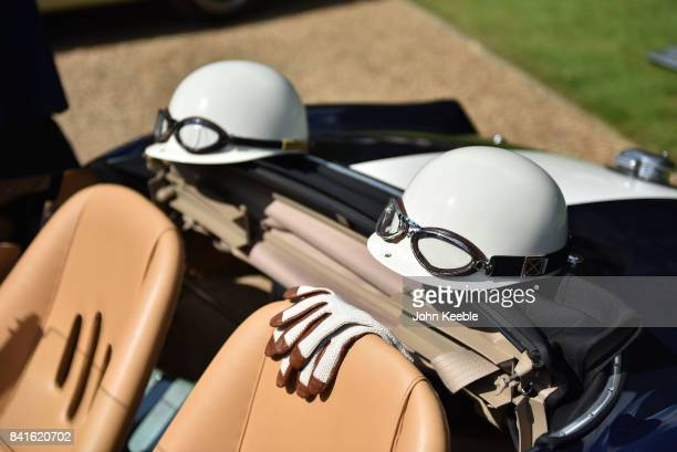 Helmets and driving gloves sit on vintage car displayed at the Concours of Elegance at Hampton Court Palace on September 1 2017 in London England The...
