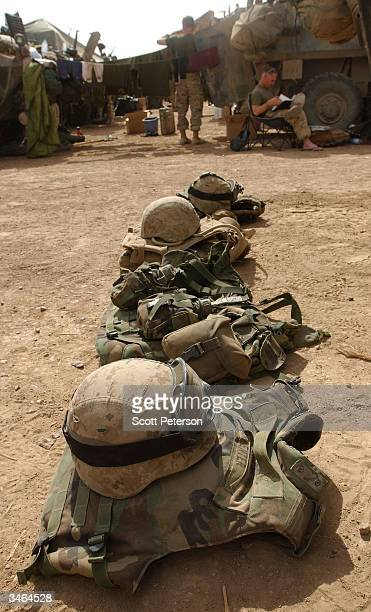 Helmets and flak vests sit ready as US Marines with the 1st Light Armored Regiment 1st Marine Expeditionary Force that controls the Anbar Province of...