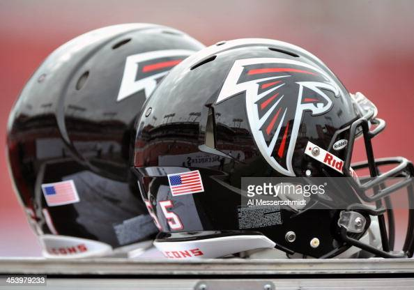 Helmets of the Atlanta Falcons are on the sidelines during play against the Tampa Bay Buccaneers November 17 2013 at Raymond James Stadium in Tampa...