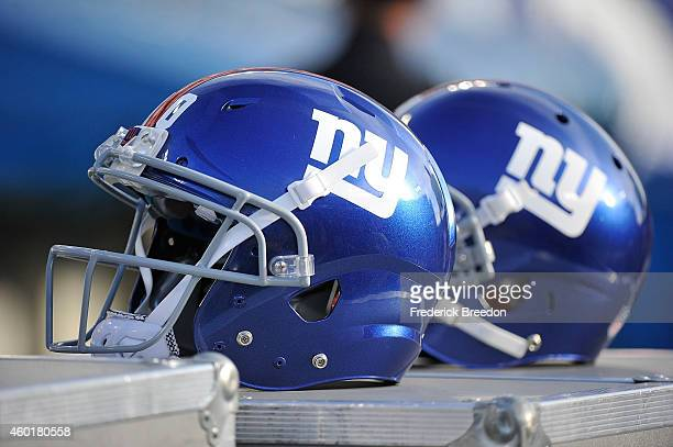 Helmets of the New York Giants rests on the sideline during a game against the Tennessee Titans at LP Field on December 7 2014 in Nashville Tennessee