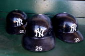 Helmets of the New York Yankees sit in the dugout against the Oakland Athletics during an MLB game at the OaklandAlameda County Coliseum on April 20...