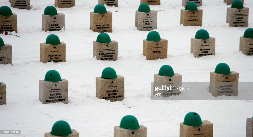 Helmets rest on top of the gravestones of the Red Army soldiers who died in the Battle of Stalingrad during the World War II, at a military cemetery in the Russian village of Rossoshka, some 40 km outside the city of Volgograd, formerly Stalingrad, on February 1, 2013. In a new display of national pride and reminder of its status as a world power, Russia remembers this weekend the Red Army victory in the battle of Stalingrad over invading Nazi forces, one of the bloodiest battles in human history. AFP PHOTO / MIKHAIL MORDASOV