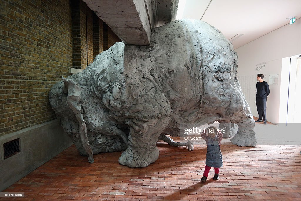 Helmi, aged 2, admires a clay sculpture of an elephant in the exhibition 'Today We Reboot the Planet' by Adrian Villar Rojas in the redeveloped Serpentine Sackler Gallery in Hyde Park on September 25, 2013 in London, England. The renovation of the 1805 gunpowder store, located on the north side of the Serpentine Bridge, was designed by Zaha Hadid Architects. The new gallery, restaurant and social space will officially open to the public on September 28, 2013.