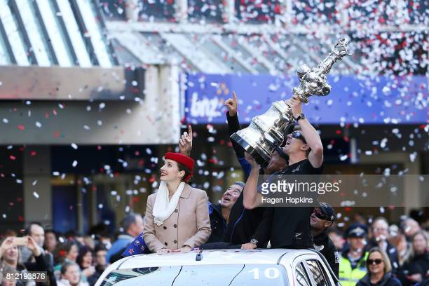 Helmsman Peter Burling holds the Americas Cup during the Team New Zealand Americas Cup Wellington Welcome Home Parade on July 11 2017 in Wellington...