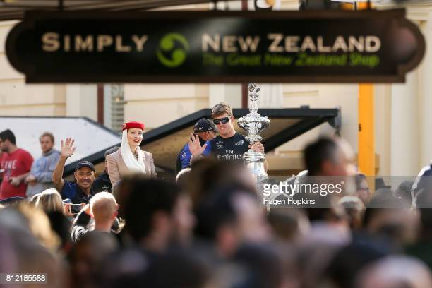 Helmsman Peter Burling holds the Americas Cup while CEO Grant Dalton looks on during the Team New Zealand Americas Cup Wellington Welcome Home Parade...