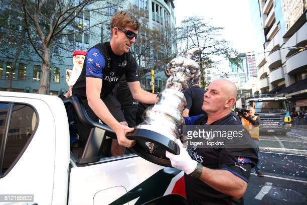 Helmsman Peter Burling offloads the Americas Cup during the Team New Zealand Americas Cup Wellington Welcome Home Parade on July 11 2017 in...