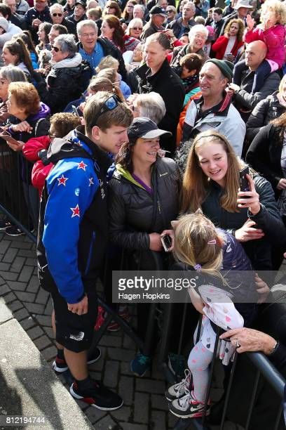 Helmsman Peter Burling speaks to fans during the Team New Zealand Americas Cup Wellington Welcome Home Parade on July 11 2017 in Wellington New...