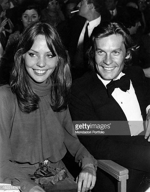 Helmut Berger and Carole André are smiling at the award ceremony of XVI David di Donatello Award Rome Theatre of Baths of Caracalla June 29 1971