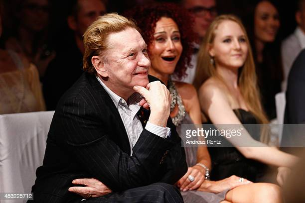 Helmut Berger and Christina aka Mausi Lugner attend the GarconF fashion show at BalloniHallen on August 5 2014 in Cologne Germany