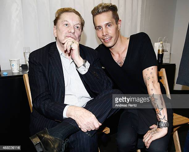Helmut Berger and designer Florian Wess attends the GarconF fashion show at BalloniHallen on August 5 2014 in Cologne Germany