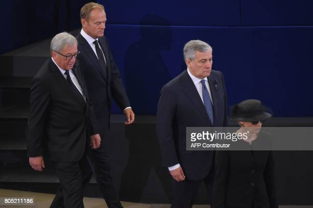 Helmut Kohl's widow Maike KohlRichter followed by President of the European Parliament Antonio Tajani President of the European Commission JeanClaude...