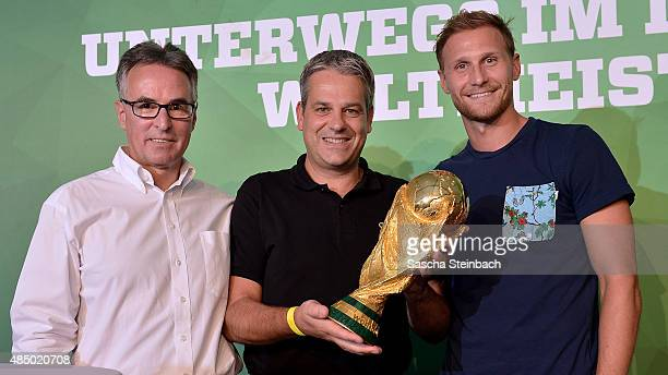 Helmut Sandrock Manuel Neukirchner and Benedikt Hoewedes attend the closing event of the 'DFB Ehrenrunde' on August 23 2015 in Kamen Germany