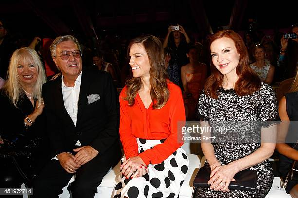 Helmut Schlotterer and his wife Ute actresses Hilary Swank and Marcia Cross attend the Marc Cain show during the MercedesBenz Fashion Week...