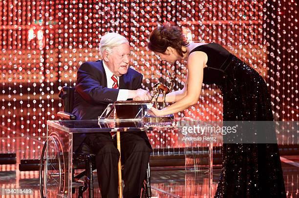 Helmut Schmidt receives the award from Sandra Maischberger during the Bambi Award 2011 show at the RheinMainHallen on November 10 2011 in Wiesbaden...