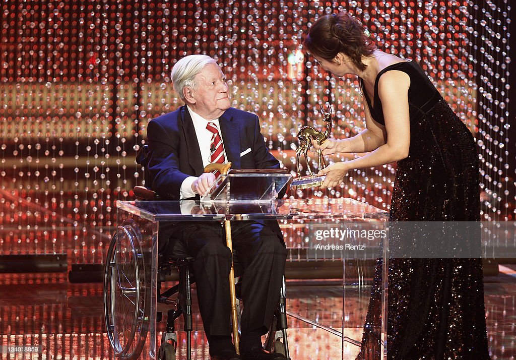 <a gi-track='captionPersonalityLinkClicked' href=/galleries/search?phrase=Helmut+Schmidt&family=editorial&specificpeople=213090 ng-click='$event.stopPropagation()'>Helmut Schmidt</a> receives the award from Sandra Maischberger during the Bambi Award 2011 show at the Rhein-Main-Hallen on November 10, 2011 in Wiesbaden, Germany.