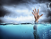 Man's Hand In Sea And Storm