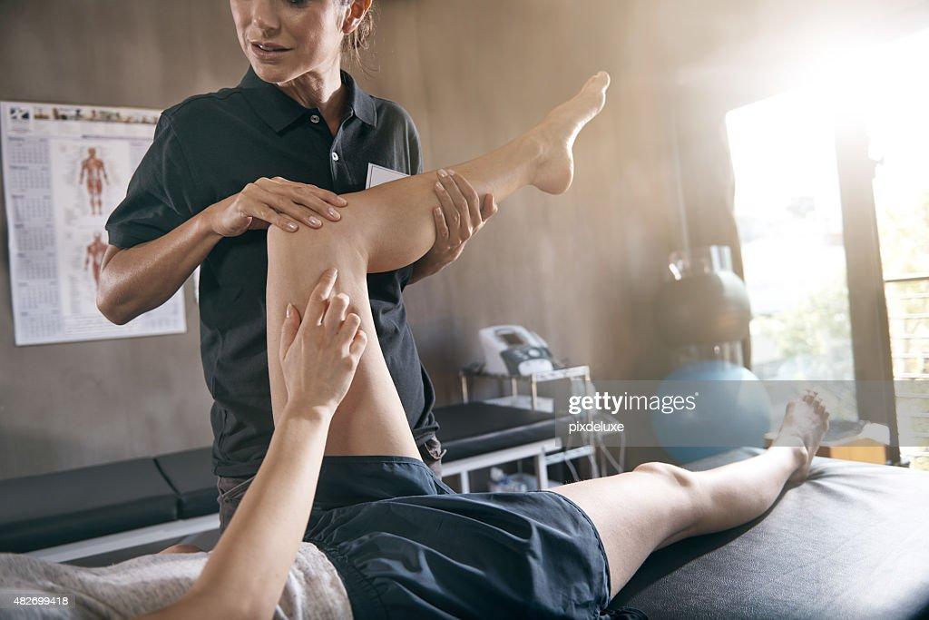 Aiuto per hurting muscoli : Foto stock