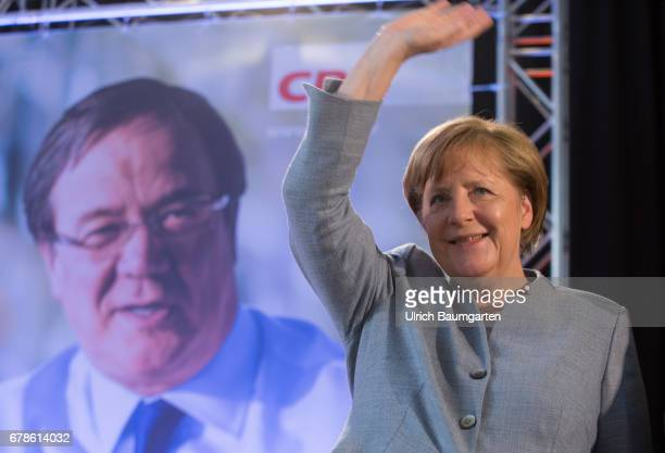 Help in the election campaign election campaign of the CDU for the regional elections in North RhineWestphalia Federal ChancellorAngela Merkel waving...