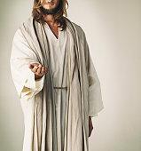 Studio shot of Jesus Christ extending his arm in assistance