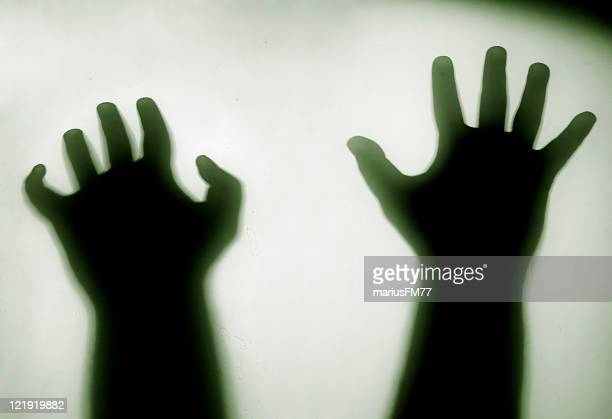help me! - ghostly hands silhouette