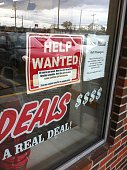 Help wanted sign at Real Deals in North Syracuse NY on October 31 2014