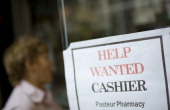 A 'Help Wanted' sign is posted in a store front window in New York US on Tuesday Sept 13 2011 US samestore sales rose 02 percent month over month...