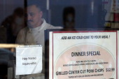 A 'help wanted' sign is posted in the window of a restaurant on September 27 2012 in San Francisco California The Labor Department reported that new...