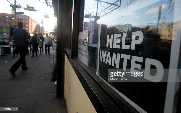 A 'help wanted' sign is seen in the window of a laundromat March 9 2010 in New York City United States job openings increased in January by 193000 to...
