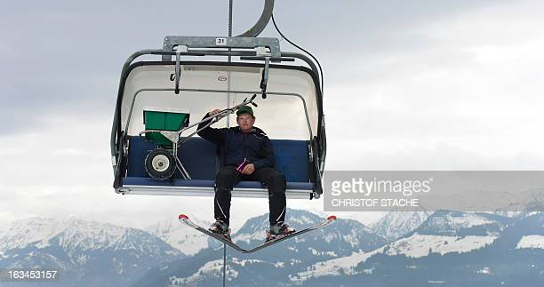 A helper transports a snow salt machine in a ski cable car cabine ahead the FIS World Cup Women's Slalom competition in Ofterschwang southern Germany...