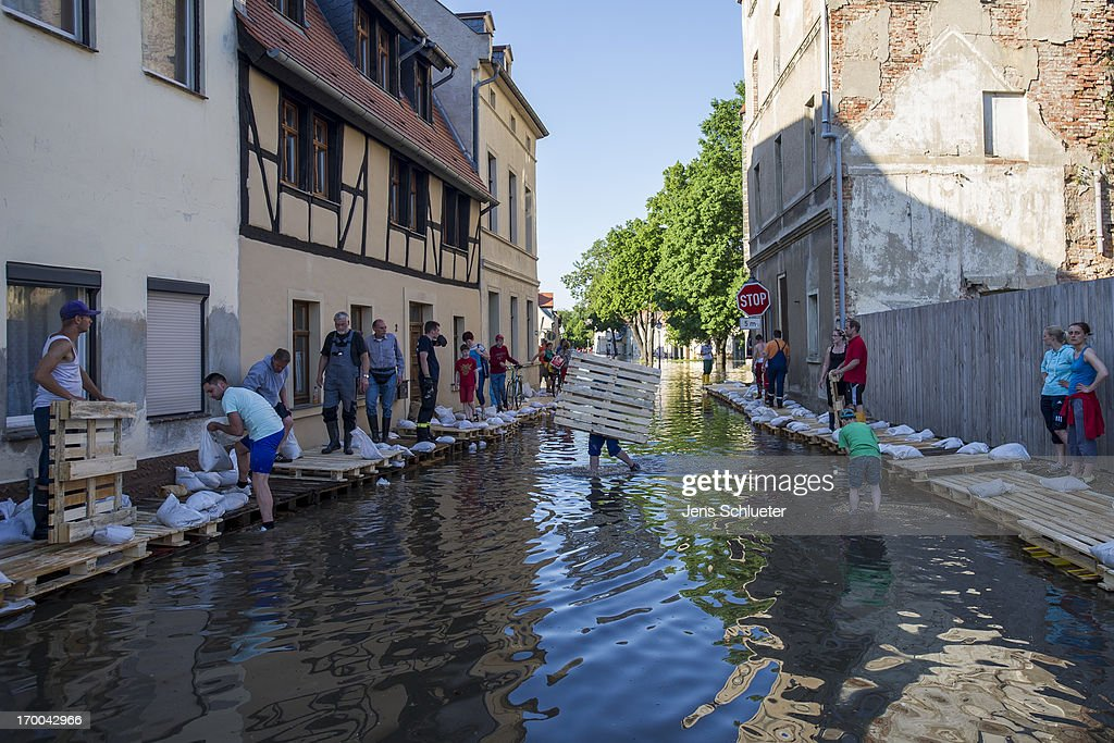 Helper work in the flooded city center on June 6, 2013 in Bernburg, Germany. Eastern and southern Germany are suffering with flooding, which in some cases is the worst in 400 years. At least four people are dead and tens of thousands have evacuated their homes.