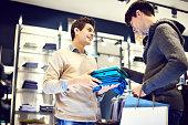 Positive shop assistant helping client
