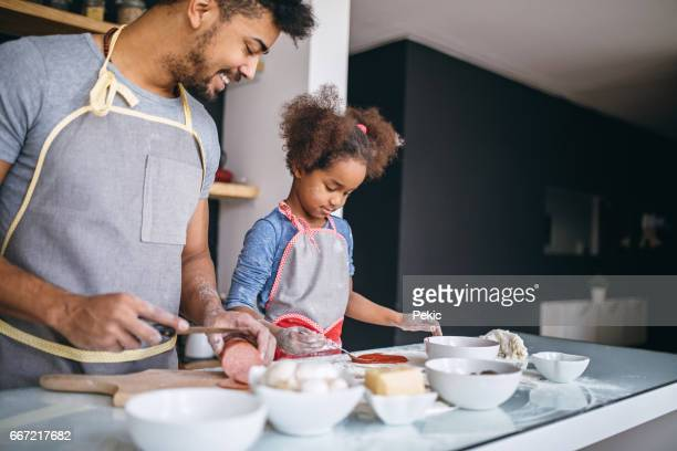Helping dad in the kitchen
