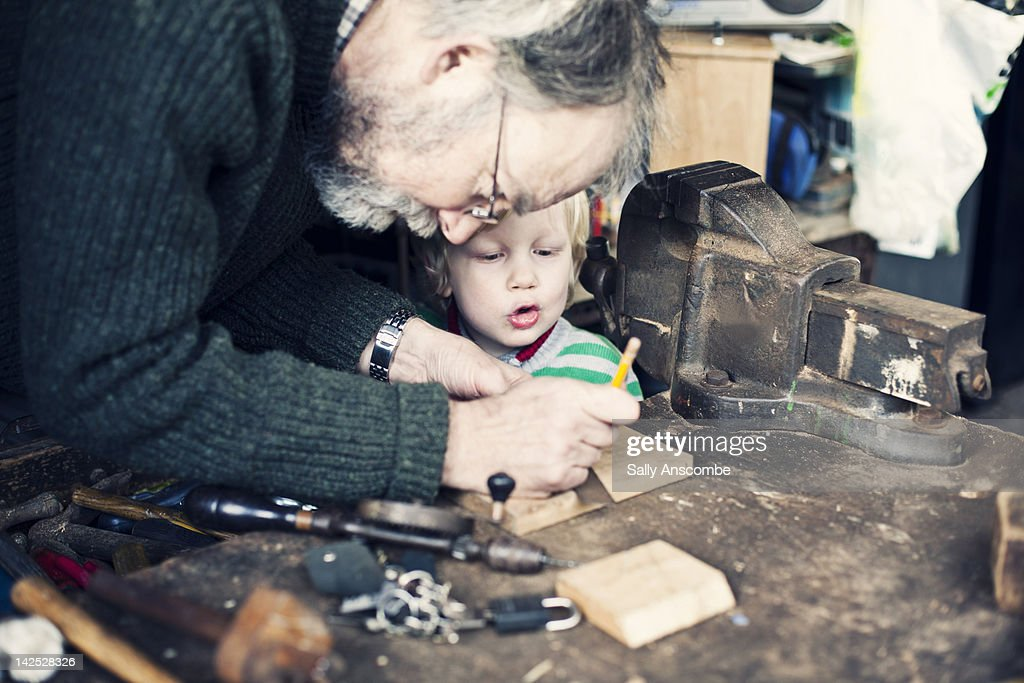 Helping Grandpa in shed. : Stock Photo