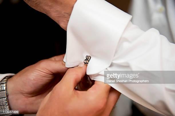 Helping Groom with cufflinks