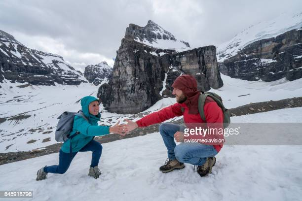 Helping hand on mountain trail