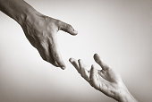 Helping hand against white background.