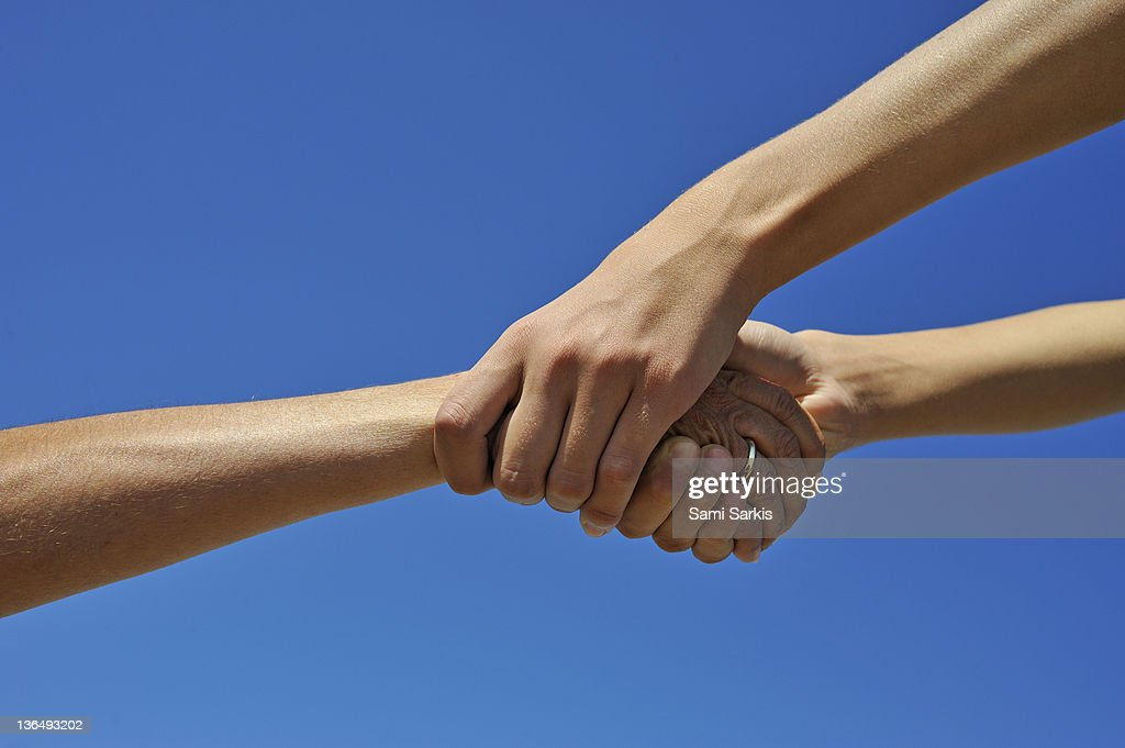 Helping hands on blue sky : Stock Photo