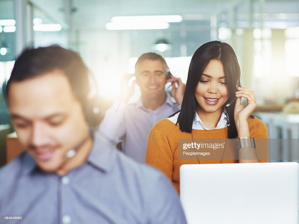 Helping her clients with a smile : Stock Photo