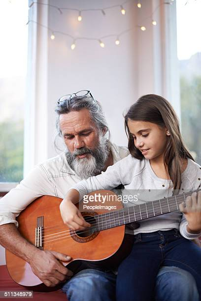 Helping her with her guitar skills