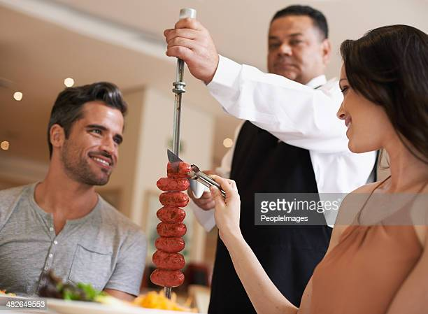 Helping herself to some delicious meat