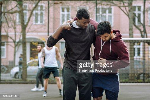 Helping Injured Team Mate