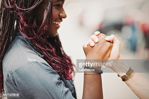 Helping mixed race female hands
