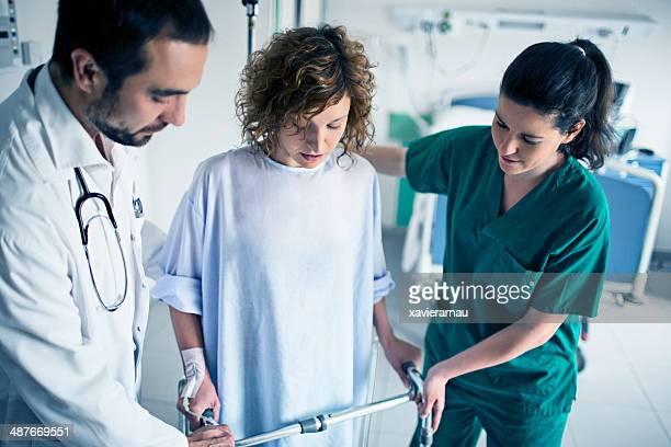 Helping patient use walker in hospital