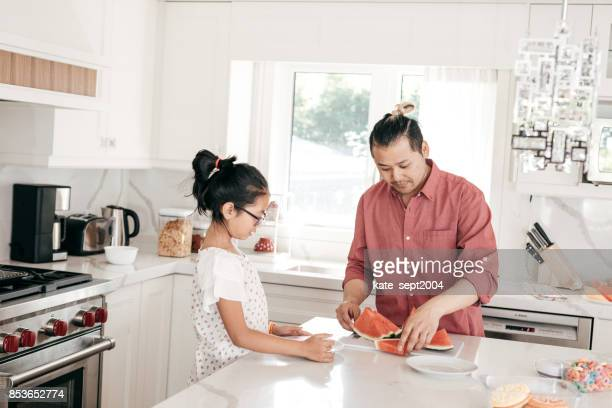 Helping to dad in the kitchen