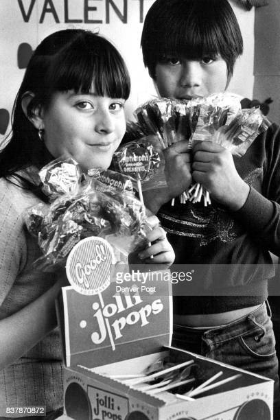 Helping To Lick Heart Disease *****Elementary fourth graders Rosalinda Barra and Randy Yazzie hold up lollipops they have received to sell as a...
