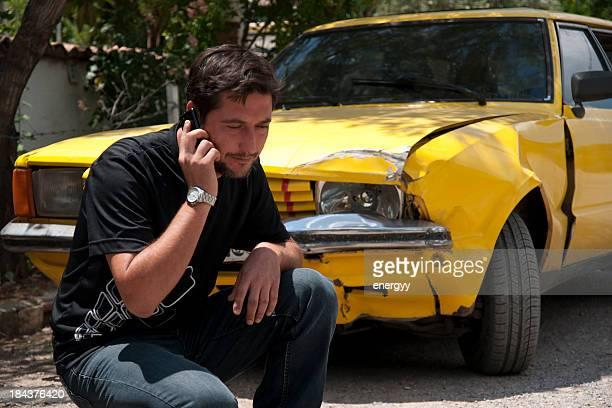 helpless man beside his car