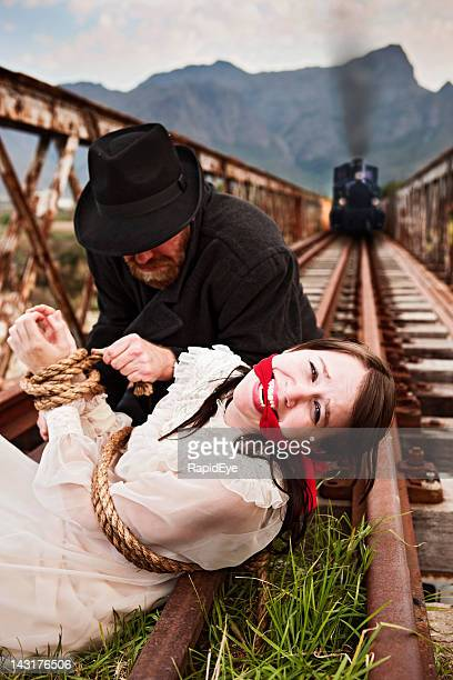 Helpless Victorian maiden wicked villain and approaching train: melodrama!