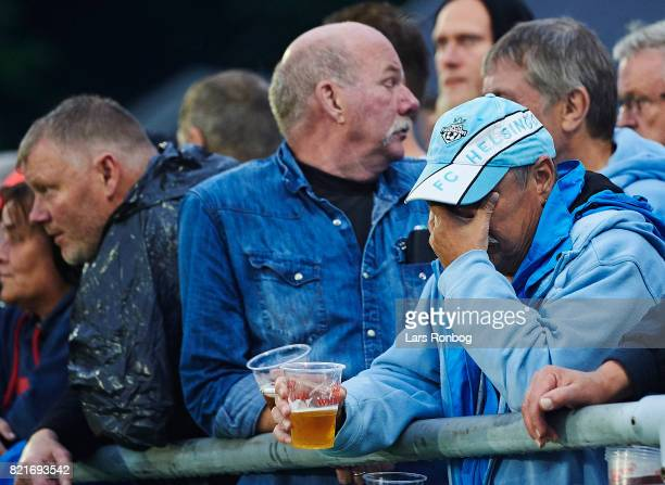 Helsingør fan looks dejected during the Danish Alka Superliga match between FC Helsingor and OB Odense at Helsingor Stadion on July 24 2017 in...