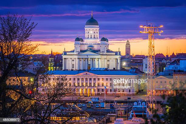Helsinki Cathedral illuminated sunset overlooking waterfront and City Hall Finland